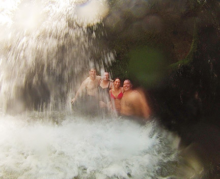 Group of friends enjoying a waterfall in Costa Rica